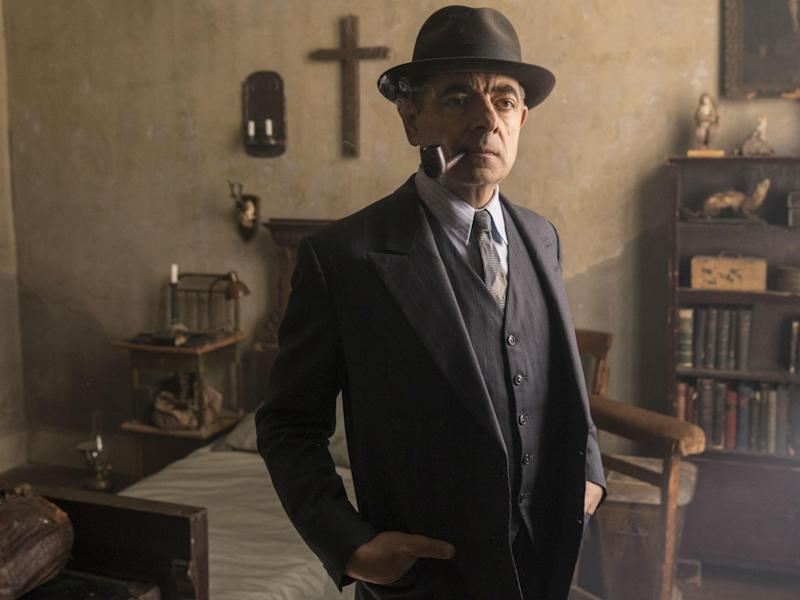 Rowan Atkinson playing the pipe-smoking French detective Maigret in ITV's 'Maigret's Night at the Crossroads': ITV
