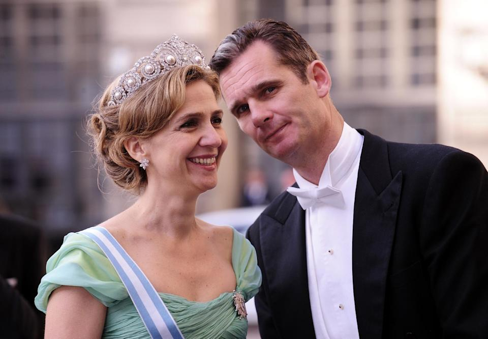 Spain's Princess Cristina and her husband Inaki Urdangarin -- who is accused of embezzlement -- arrive at the Royal Palace in Stockholm, in 2010 (AFP Photo/Attila Kisbenedek)
