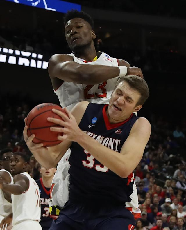 <p>Nick Muszynski #33 of the Belmont Bruins controls the ball against Bruno Fernando #23 of the Maryland Terrapins in the first half during the first round of the 2019 NCAA Men's Basketball Tournament at VyStar Jacksonville Veterans Memorial Arena on March 21, 2019 in Jacksonville, Florida. (Photo by Sam Greenwood/Getty Images) </p>