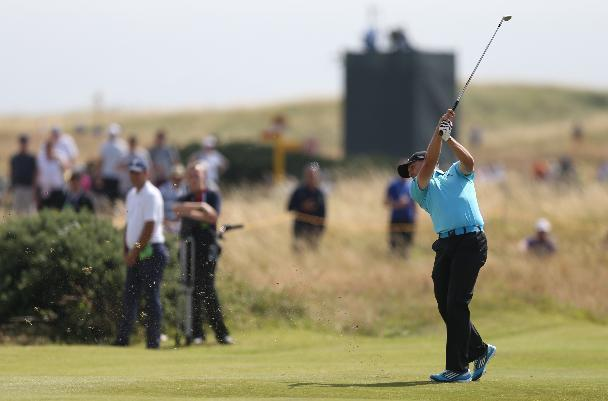 Sergio Garcia of Spain plays a shot on the 8th fairway during the final round of the British Open Golf championship at the Royal Liverpool golf club, Hoylake, England, Sunday July 20, 2014. (AP Photo/Scott Heppell)