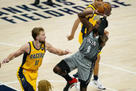 Brooklyn Nets forward Jeff Green (8) shoots over Indiana Pacers forward Domantas Sabonis (11) during the second half of an NBA basketball game in Indianapolis, Wednesday, March 17, 2021. (AP Photo/Michael Conroy)