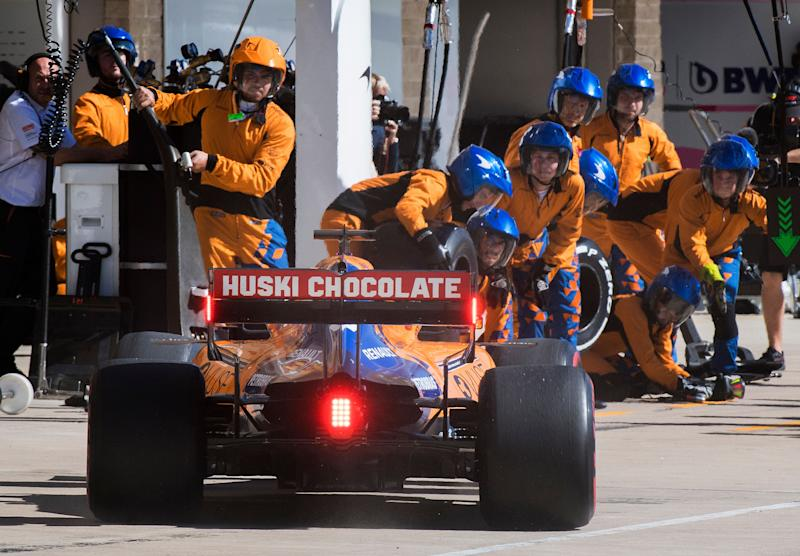 McLaren driver Carlos Sainz, of Spain, enters the pit as the team's crew members watch during the Formula One US Grand Prix auto race at the Circuit of the Americas in Austin, Texas, Sunday, Nov. 3, 2019. (Photo: ASSOCIATED PRESS)