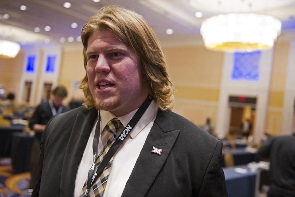 Ty Darlington, University of Oklahoma offensive lineman and student delegate, speaks with reporters following the NCAA's Autonomy Business Session during the final day of NCAA Convention in Oxon Hill, Md., Saturday, Jan. 17, 2015. The five most powerful and wealthiest conferences in college sports passed NCAA legislation that increases the value of an athletic scholarship by several thousand dollars to cover the federally determined actual cost of attendance. (AP Photo/Cliff Owen)