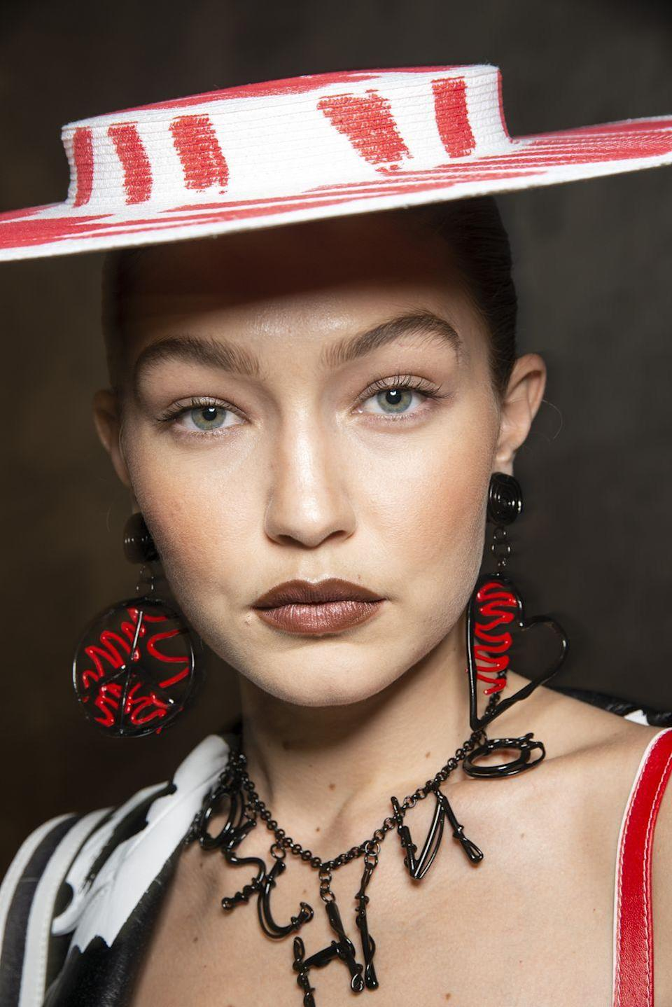 <p>Fluffy brows, major cheekbones and 90s style brown lipstick give a going out out look a retro twist.</p>