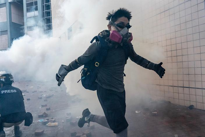 Protesters run on a street during an attempt to leave The Hong Kong Polytechnic University on November 18, 2019 in Hong Kong, China. (Photo: Anthony Kwan/Getty Images)