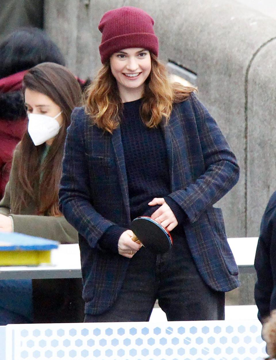 <p>Lily James plays a round of table tennis with actor Shazad Latif while filming <em>What's Love Got to Do with It</em> in Southwark, London.</p>