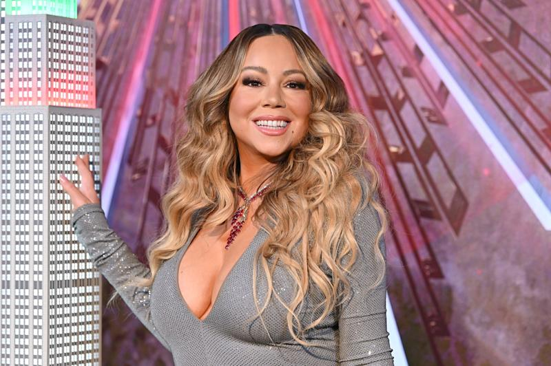 NEW YORK, NEW YORK - DECEMBER 17: Mariah Carey lights the Empire State Building in celebration of the 25th anniversary of