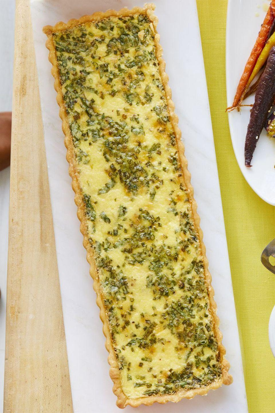 """<p>Frozen puff pastry, who? Make your own pie crust from scratch and then fill it with this cheesy egg mixture. </p><p><a class=""""link rapid-noclick-resp"""" href=""""https://www.amazon.com/Gobel-Rectangular-Tart-Pan-14/dp/B00004S1BW?tag=syn-yahoo-20&ascsubtag=%5Bartid%7C10055.g.428%5Bsrc%7Cyahoo-us"""" rel=""""nofollow noopener"""" target=""""_blank"""" data-ylk=""""slk:SHOP RECTANGULAR TART PANS"""">SHOP RECTANGULAR TART PANS</a></p><p><em><a href=""""https://www.womansday.com/food-recipes/food-drinks/a19122269/cheese-and-herb-quiche-recipe/"""" rel=""""nofollow noopener"""" target=""""_blank"""" data-ylk=""""slk:Get the recipe from Woman's Day »"""" class=""""link rapid-noclick-resp"""">Get the recipe from Woman's Day »</a></em></p>"""