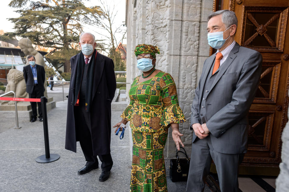 New Director-General of the World Trade Organisation Ngozi Okonjo-Iweala, center, speaks between WTO Deputy Directors-General Alan Wolff, left, and Karl Brauner upon her arrival at the WTO headquarters to takes office in Geneva, Switzerland, Monday, March 1, 2021. Nigeria's Ngozi Okonjo-Iweala takes the reins of the WTO amid hope she will infuse the beleaguered body with fresh momentum to address towering challenges and a pandemic-fuelled global economic crisis. (Fabrice Coffrini/Pool/Keystone via AP)