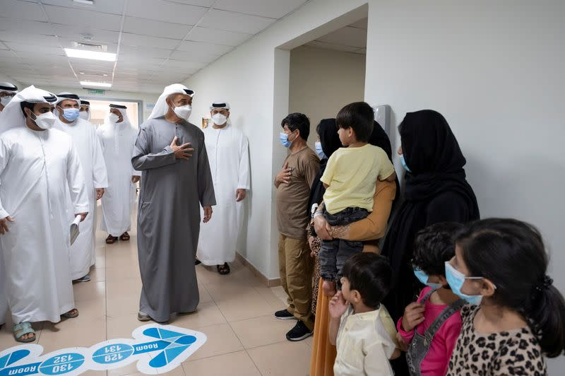 FILE PHOTO: Abu Dhabi's Crown Prince Sheikh Mohammed bin Zayed al-Nahyan visits evacuee families from Afghanistan at Emirates Humanitarian City in Abu Dhabi