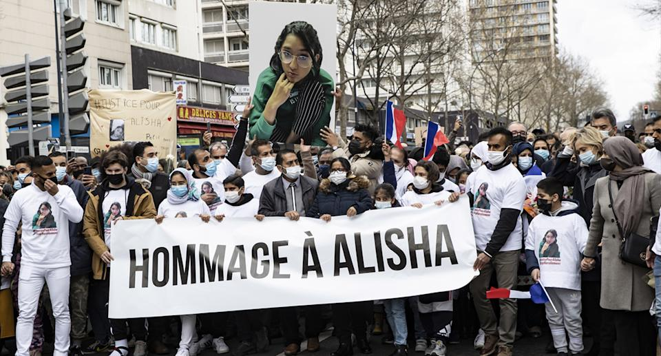 The parents of 14-year-old Alisha lead a vigil march, dubbed a 'white march' in memory of their daughter Alisha, in Argenteuil, outside Paris, France. Source: AAP