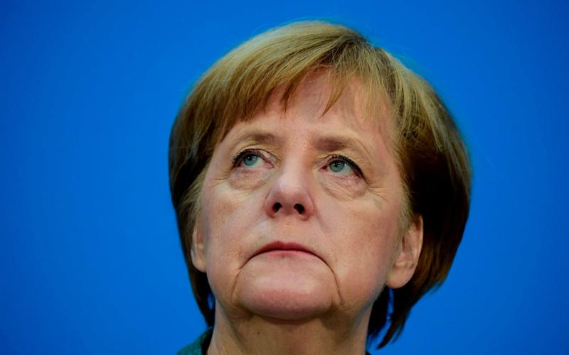 Angela Merkel is under mounting pressure at home over her migration policy as EU leaders meet for a Brussels 'mini-summit'. - AFP