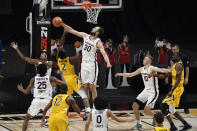 Virginia's Jay Huff (30) blocks a shot attempt by Towson's Zane Martin (2) in the second half of an NCAA college basketball game, Wednesday, Nov. 25, 2020, in Uncasville, Conn. (AP Photo/Jessica Hill)
