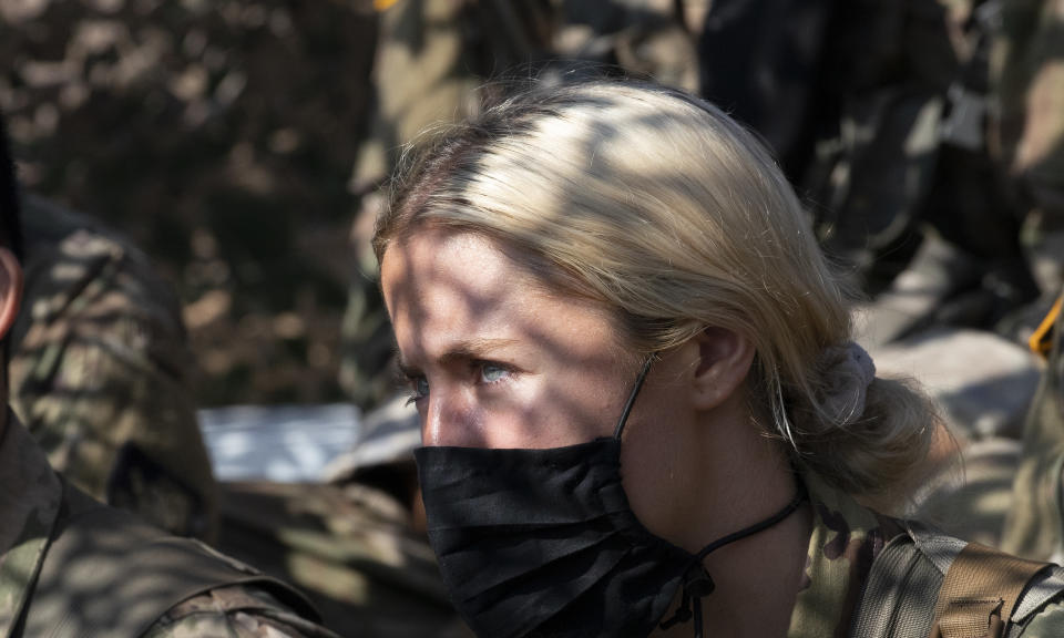 Madison Warne, of Valhalla, N.Y, listens to instructions at a mortar range, Friday, Aug. 7, 2020, at the U.S. Military Academy in West Point, N.Y. The pandemic is not stopping summer training at West Point. Cadets had to wear masks this year for much of the training as the future U.S. Army officers learned military skills. (AP Photo/Mark Lennihan)