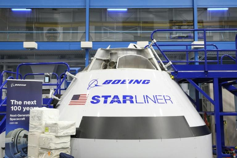 (FILES) In this file photo taken on October 23, 2018 a mockup of the Boeing Starliner spacecraft is seen inside the Space Vehicle Mockup Facility during a media preview for an upcoming public open house at NASA's Johnson Space Center in Houston
