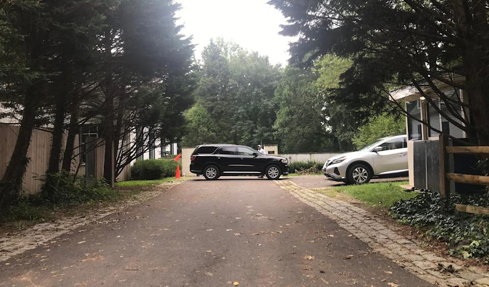 A black SUV sits outside Joe Biden's Greenville, Delaware residence on Tuesday as speculation about his pick for a vice presidential candidate ramped up.