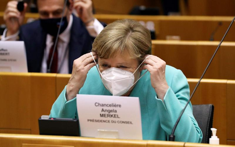 German Chancellor Angela Merkel wears a protective face mask as she attends a plenary session at the European Parliament in Brussels on July 8, 2020 upon the presentation of the German programme for EU presidency. - Yves Herman/AFP