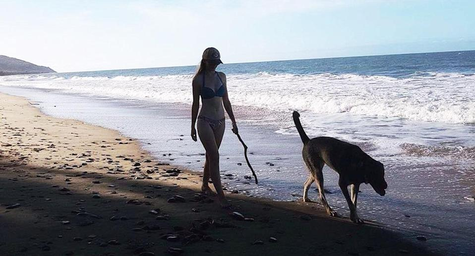 Ms Cordingley, whose large dog was found uninjured on Monday, would have been easily noticeable on what was traditionally a quiet stretch of sand, police said. Image: Facebook/Toyah Cordingley