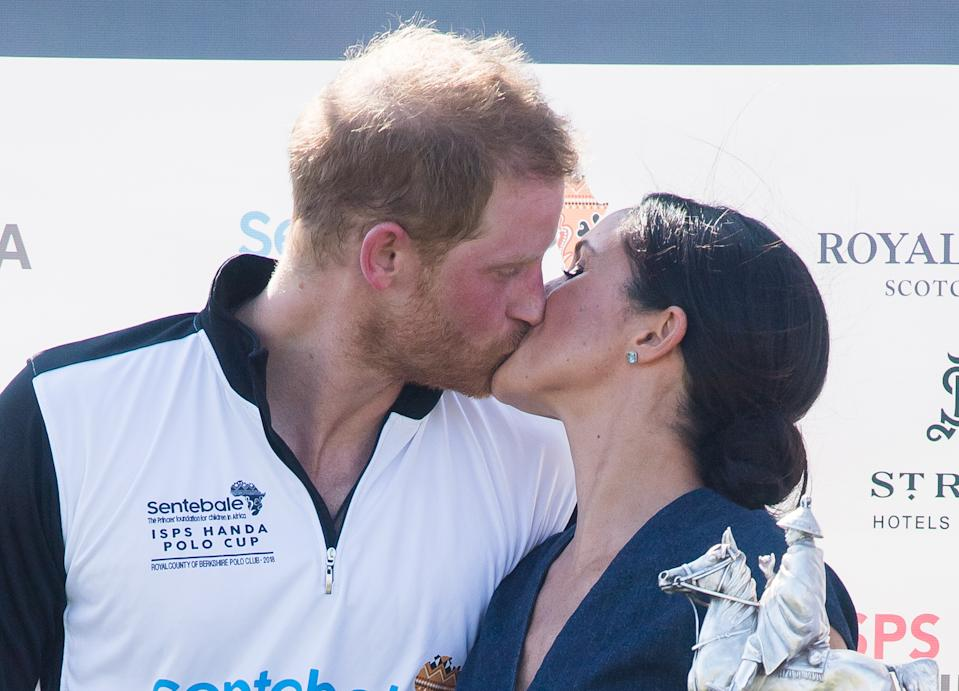 Prince Harry and Meghan Markle previously shared a smooch at the Sentebale Polo in 2018. (Photo: Getty)