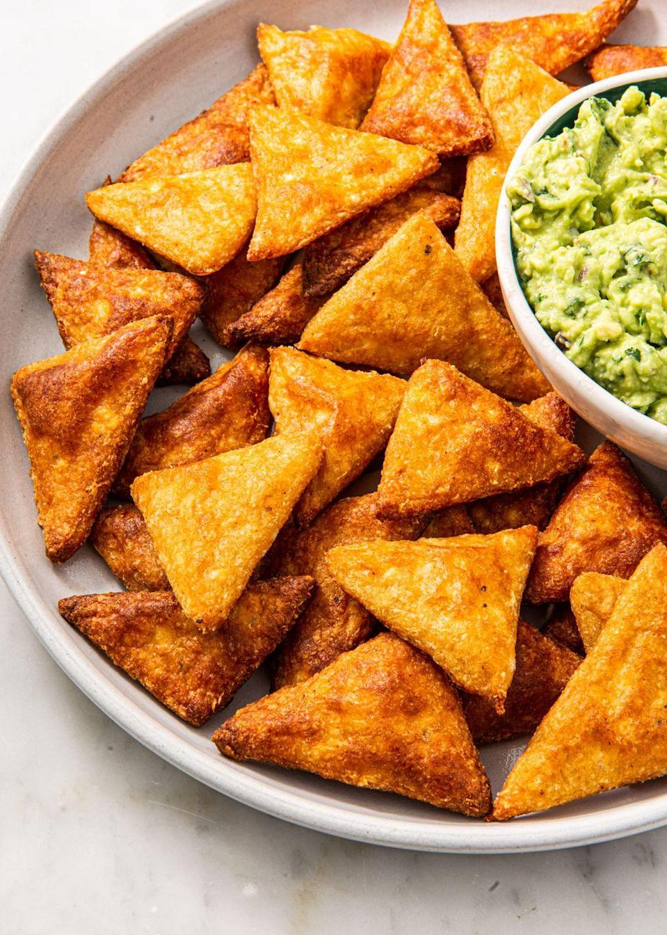 "<p>Can be served with guac, buffalo chicken dip, or any of our other noteworthy sides.</p><p>Get the recipe from <a href=""https://www.delish.com/cooking/recipe-ideas/a30326338/keto-tortilla-chips/"" rel=""nofollow noopener"" target=""_blank"" data-ylk=""slk:Delish"" class=""link rapid-noclick-resp"">Delish</a>.</p>"