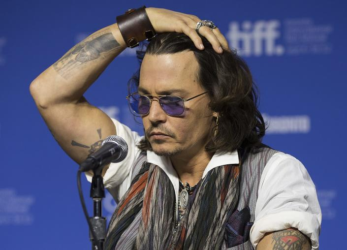 "Actor Johnny Depp gestures a press conference to show his support for the documentary ""West of Memphis"" at the 2012 Toronto International Film Festival in Toronto on Saturday, Sept. 8, 2012. (AP Photo/The Canadian Press, Michelle Siu)"