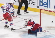 New York Rangers' Artemi Panarin scores against Montreal Canadiens goaltender Carey Price during the third period of an NHL hockey game Saturday, Nov. 23, 2019, in Montreal. (Graham Hughes/The Canadian Press via AP)