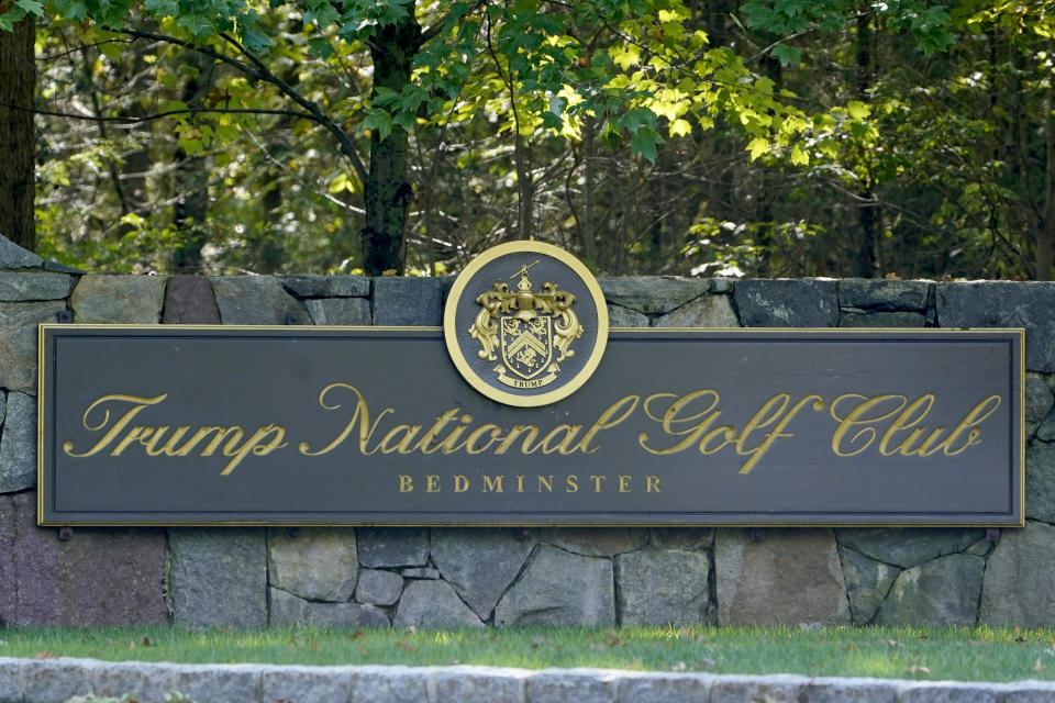 A sign is seen at the entrance to Trump National Golf Club in Bedminster, N.J., Friday, Oct. 2, 2020.  With just a month to go until the election, President Donald Trump had a busy schedule in the week before the coronavirus hit home with him. Trump tweeted early Friday that he and first lady Melania Trump had tested positive for the coronavirus. (AP Photo/Seth Wenig)