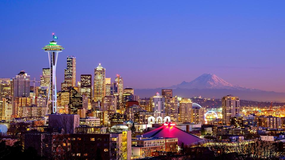 A scenic view of the Space Needle in Seattle, WA and the Mt. Rainier