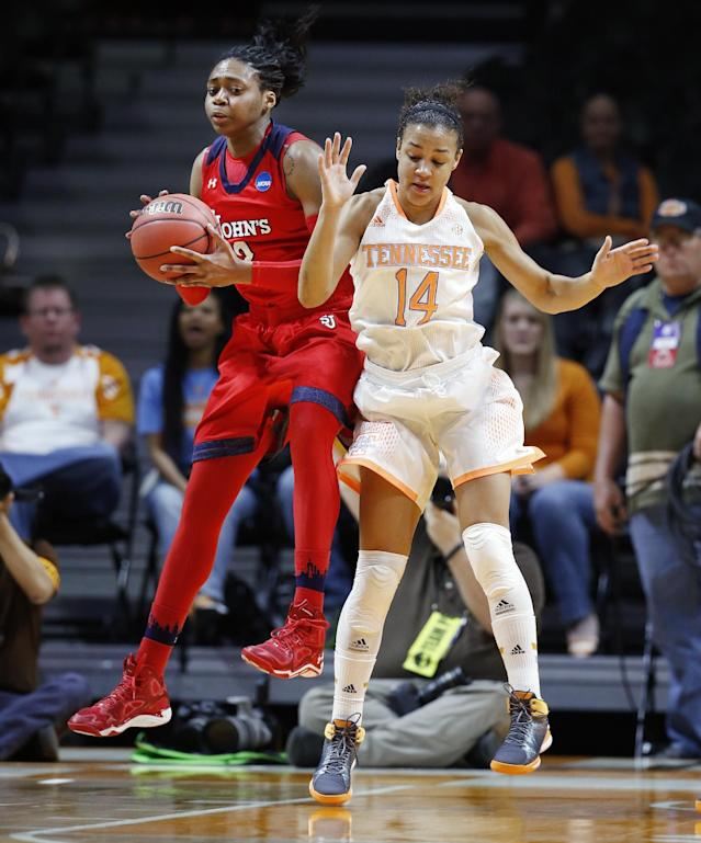St. John's forward Amber Thompson, left, pulls a rebound away from Tennessee guard Andraya Carter (14) in the first half of an NCAA women's college basketball second-round tournament game Monday, March 24, 2014, in Knoxville, Tenn. (AP Photo/John Bazemore)