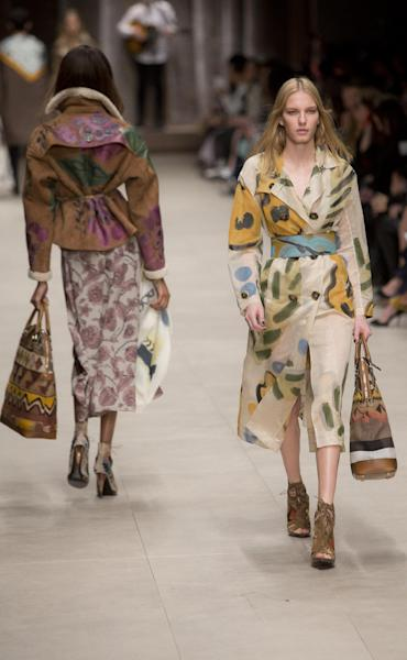 Models wear designs created by Burberry Prorsum Womenswear during London Fashion Week Autumn/Winter 2014, at Perks Field, Kensington Palace, in Hyde Park, central London, Monday, Feb. 17, 2014. (Photo by Joel Ryan/Invision/AP)