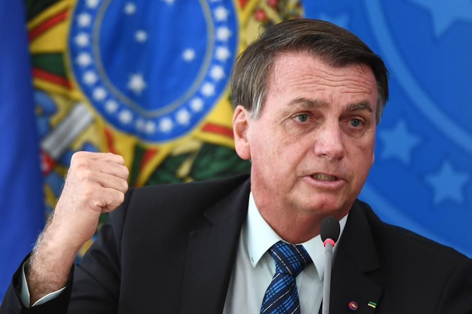 Brazilian President Jair Bolsonaro gestures as he speaks during a press conference on a new fuel tax policy at Planalto Palace in Brasilia on February 5, 2021. (Photo by EVARISTO SA / AFP) (Photo by EVARISTO SA/AFP via Getty Images)