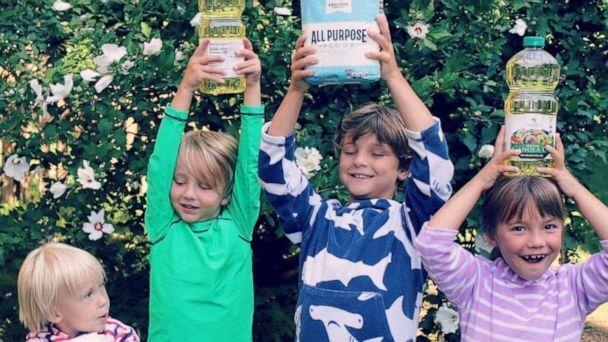 PHOTO: Sterling and Amber Marchand's four children hold food the family has collected for their Be The Good Project. (Amber and Sterling Marchand/Be The Good Project)