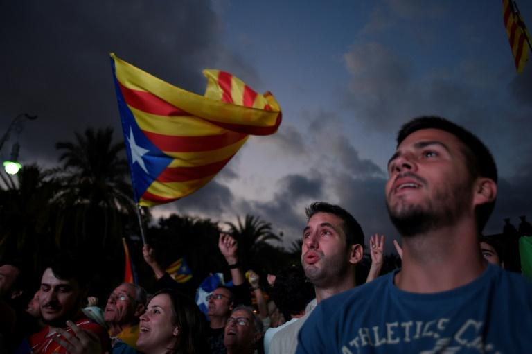 Catalan leader Carles Puigdemont's speech to parliament was watched by crowds on a television screen in Barcelona