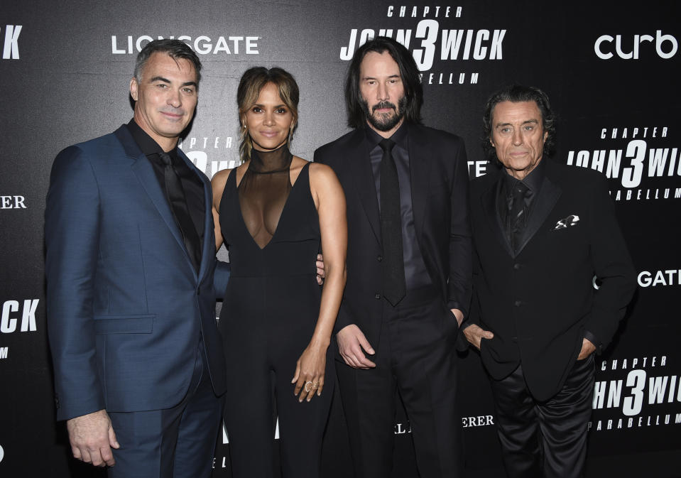 """Director Chad Stahelski, left, poses with actors Halle Berry, Keanu Reeves and Ian McShane at the world premiere of """"John Wick: Chapter 3 - Parabellum,"""" at One Hanson, Thursday, May 9, 2019, in New York. (Photo by Evan Agostini/Invision/AP)"""