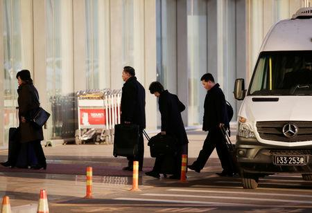 North Korean officials arrive at the international airport as they leave for Washington from Beijing, China January 17, 2019. REUTERS/Jason Lee