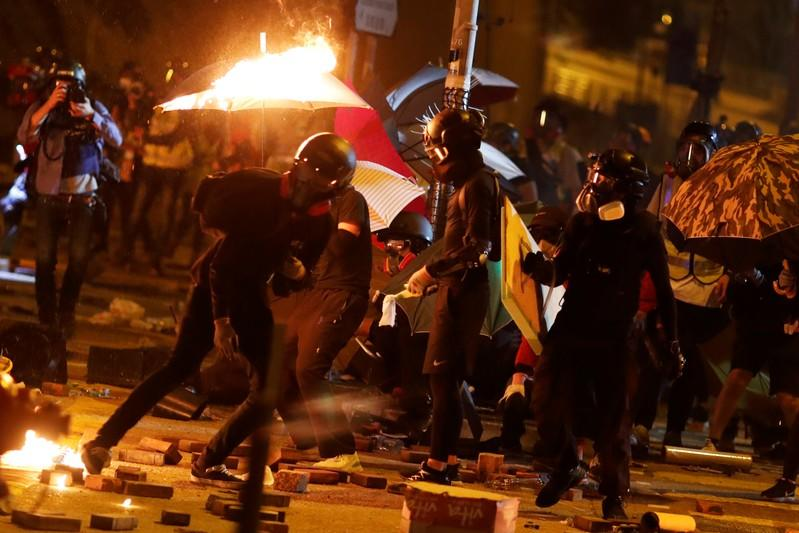 Anti-government protesters are seen during the clashes with a police near the Polytechnic University in Hong Kong