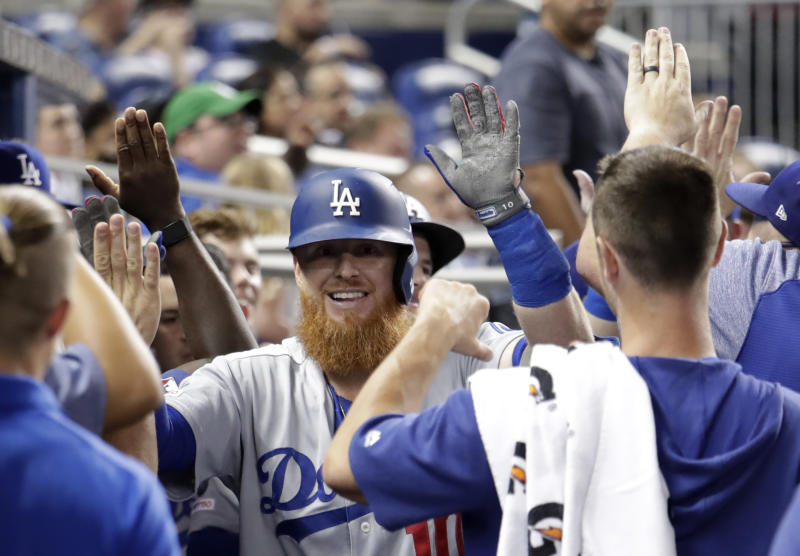 Smith hits 2 of Dodgers' 6 HRs as they pound Marlins 15-1