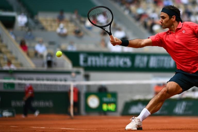 On the stretch: Roger Federer returns the ball to Marin Cilic