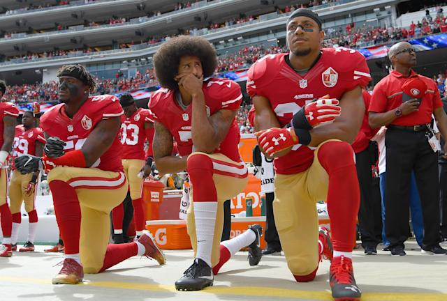 Eric Reid, right, has been a friend an ally of Colin Kaepernick's throughout his ordeal with the NFL since they were 49ers teammates. (Thearon W. Henderson/Getty Images)