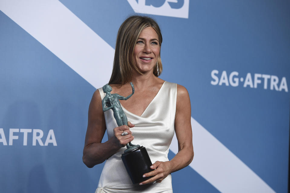 "Jennifer Aniston poses in the press room with the award for outstanding performance by a female actor in a drama series for ""The Morning Show"" at the 26th annual Screen Actors Guild Awards at the Shrine Auditorium & Expo Hall on Sunday, Jan. 19, 2020, in Los Angeles. (Photo by Jordan Strauss/Invision/AP)"