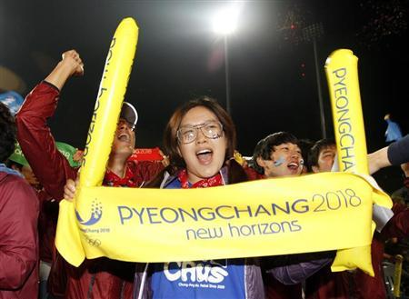 South Koreans celebrate as they hear that Pyeongchang won in a first round of voting for the 2018 Winter Olympics Games in Pyeongchang