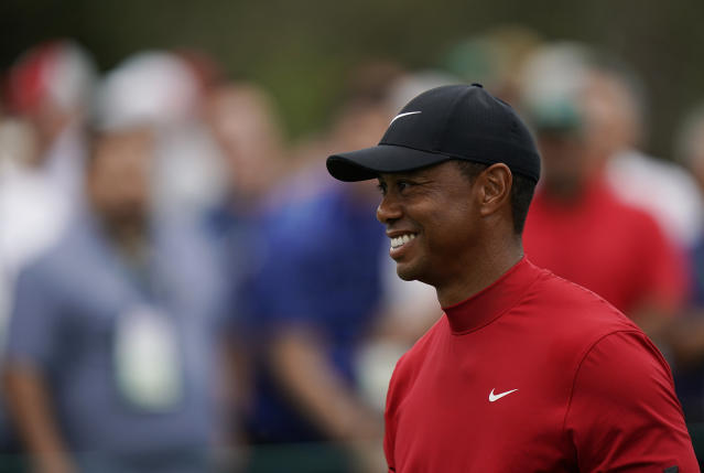Tiger Woods smiles as he walks off the seventh tee during the final round for the Masters golf tournament, Sunday, April 14, 2019, in Augusta, Ga. (AP Photo/David J. Phillip)