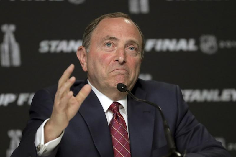 FILE - In this May 27, 2019, file photo, NHL Commissioner Gary Bettman speaks to the media before Game 1.