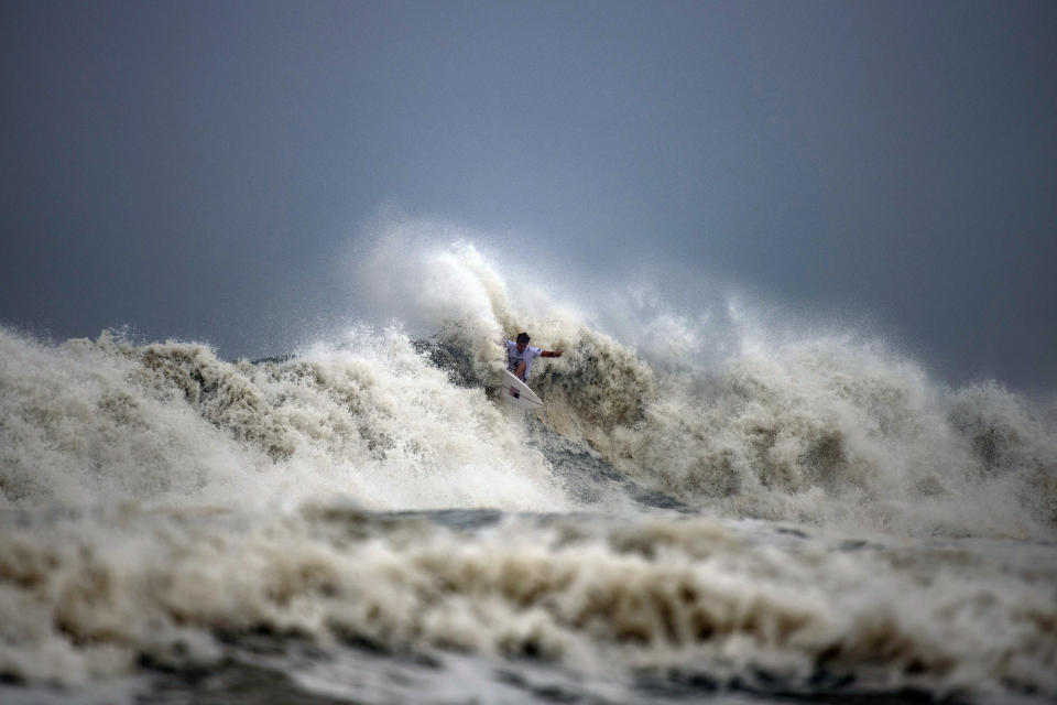 Kolohe Andino, of the United States, rides a wave during the quarterfinals of the men's surfing competition at the 2020 Summer Olympics, Tuesday, July 27, 2021, at Tsurigasaki beach in Ichinomiya, Japan. (Olivier Morin/Pool Photo via AP)