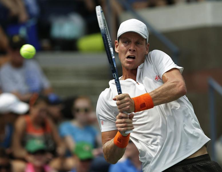 Tomas Berdych, of the Czech Republic returns a shot to Julien Benneteau, of France, during the third round of the 2013 U.S. Open tennis tournament, Sunday, Sept. 1, 2013, in New York. (AP Photo/Kathy Willens)