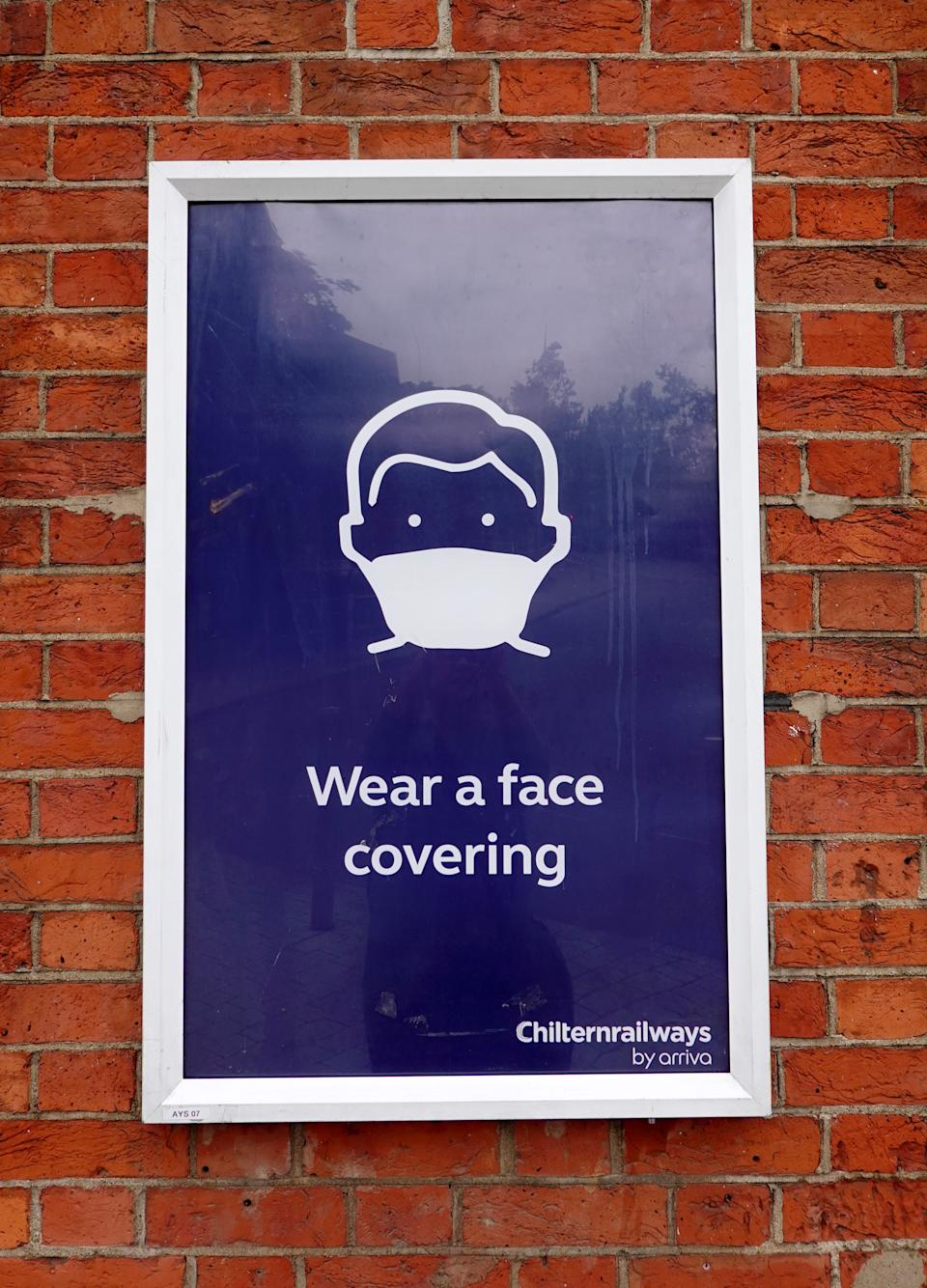 AYLESBURY, ENGLAND - JUNE 12: Notices at a railway station advising the public to wear a mask, wash hands and travel off-peak if possible on June 12, 2020 in Aylesbury, England .As the British government further relaxes Covid-19 lockdown measures in England, this week sees preparations being made to open non-essential stores and Transport for London handing out face masks to commuters. International travelers arriving in the UK will face a 14-day quarantine period. (Photo by Catherine Ivill/Getty Images)