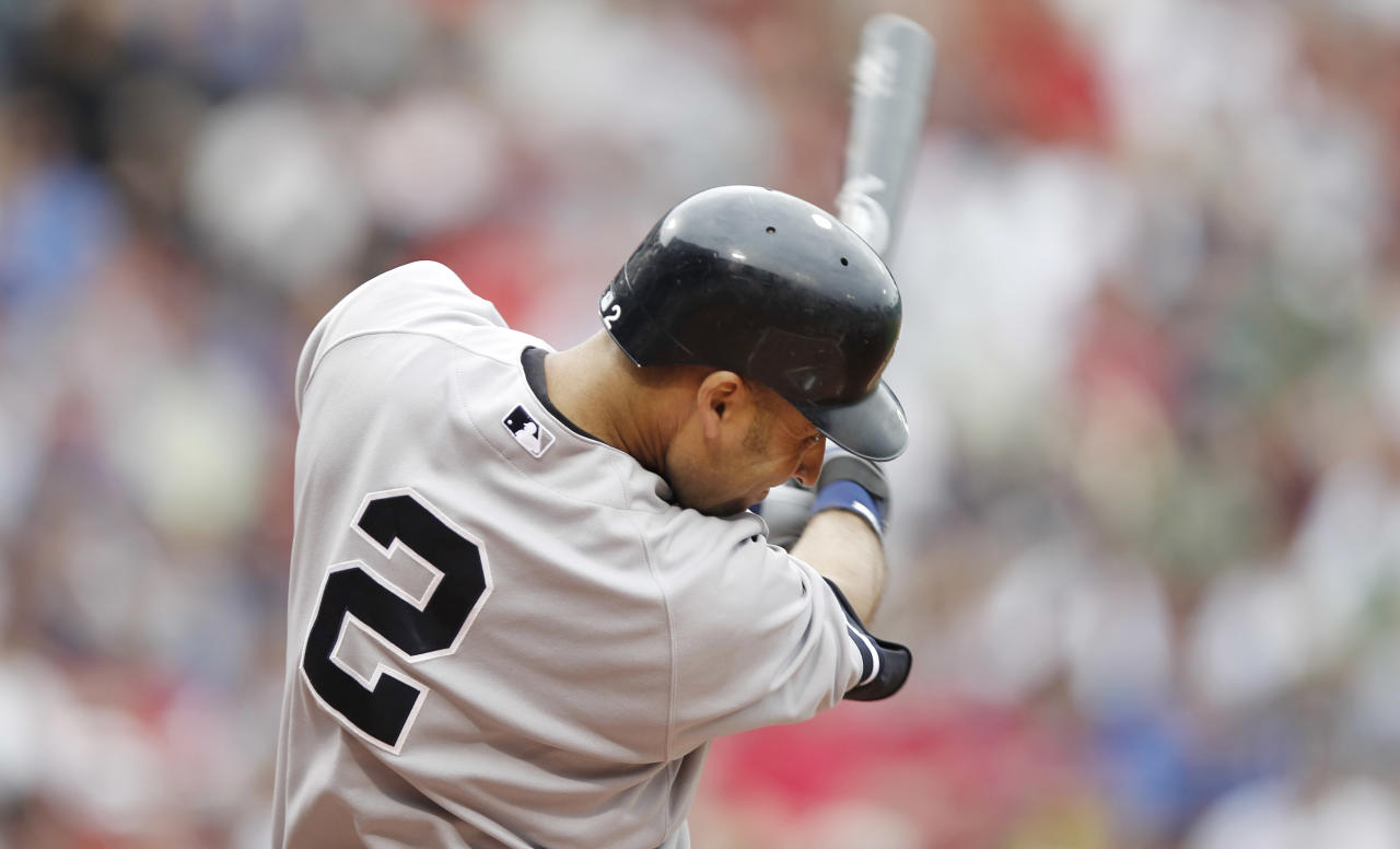 BOSTON, MA - JULY 7: Derek Jeter #2 of the New York Yankees singles during the first inning of game one of a doubleheader against the Boston Red Sox at Fenway Park on July 7, 2012 in Boston, Massachusetts. (Photo by Winslow Townson/Getty Images)