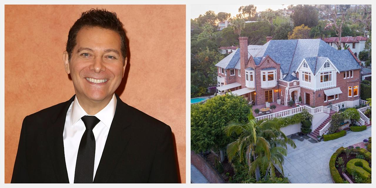 """<p>Singer and five-time Grammy-nominated entertainer Michael Feinstein has <a href=""""https://www.elliman.com/california/2405-glendower-avenue-los-feliz-thidsrs"""" target=""""_blank"""">relisted</a> his Los Feliz, California, mansion for $18.9 million. The self-styled """"Ambassador of The Great American Songbook"""" and his husband, Terrance Flannery, decided to put their historic mansion back on the market after extensive restaging. The home was previously listed at $26 million in April 2018. According to the <a href=""""https://www.latimes.com/archives/la-xpm-1998-mar-01-re-24194-story.html"""" target=""""_blank"""">Los Angeles Times</a>, Feinstein purchased the home in 1998 for around $2.5 million. The 15,391-square-foot manse previously served as the Russian Consulate from 1935 to the early 1950s, and since then has hosted some of Hollywood's biggest names. The stately Tudor Revival-style home is a magnificent edifice, situated 15-feet above street level, surrounded by lush greenery and meticulously manicured gardens. With both ocean and city views and exceptional privacy, the mansion is the only of its kind in the area.</p><p><em>The home is listed by Ernie Carswell of Douglas Elliman in association with Tom Postilio and Mickey Conlon of Elliman's New York office. Mr. Carswell is co-listing the property with Dorothy Carter and Michael Orland of Keller Williams.</em><br></p><p>Tour Michael Feinstein's entire home below.</p>"""