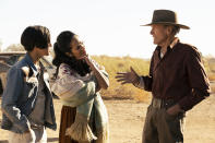"""This image released by Warner Bros. Pictures shows Eduardo Minett, from left, Natalia Traven and Clint Eastwood in a scene from """"Cry Macho."""" (Claire Folger/Warner Bros. Pictures via AP)"""