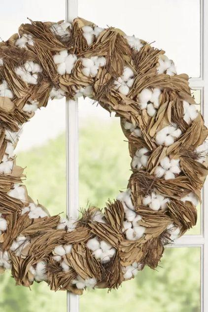 <p>The combination of cotton and dried leaves creates a soft, inviting feel. </p>